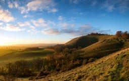 Stunning Autumn sunrise over countryside landscape Stock Photos
