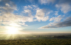 Stunning Autumn sunrise over countryside landscape Royalty Free Stock Photos