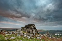 Stunning Autumn sunset landscape image of view from Leather Tor. Beautiful Autumn sunset landscape image of view from Leather Tor in Dartmoor National Park royalty free stock photography