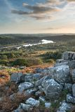 Stunning Autumn sunset landscape image of view from Leather Tor. Beautiful Autumn sunset landscape image of view from Leather Tor towards Burrator Reservoir in royalty free stock photo