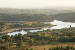 Stunning Autumn sunset landscape image of view from Leather Tor. Beautiful Autumn sunset landscape image of view from Leather Tor towards Burrator Reservoir in royalty free stock photography