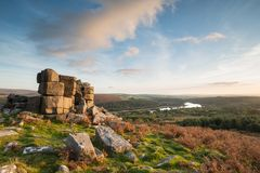Stunning Autumn sunset landscape image of view from Leather Tor. Beautiful Autumn sunset landscape image of view from Leather Tor towards Burrator Reservoir in stock photo