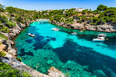 Stunning bay Cala Pi beach on Majorca island Spain. Picturesque island scenery, idyllic bay with boats at the beach Cala Pi on Mallorca, Spain Mediterranean Sea Royalty Free Stock Images