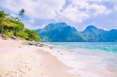 Stunning beach on Helicopter Island in the Bacuit archipelago in El Nido, Cadlao Island in Background, Palawan Royalty Free Stock Photo