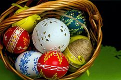 Stunning beautiful carved and painted Easter eggs of different colors. Christian tradition during the great Easter holiday. Basket full of Easter eggs for the Royalty Free Stock Photo
