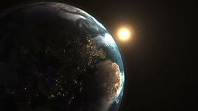 Stunning beautiful dawn in space, the sun comes from behind the planet Earth stock video footage