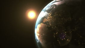 Stunning beautiful dawn in space, the sun comes from behind the planet Earth stock footage