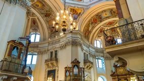 Stunning and beautiful details of sculpture, painting and decoration in baroque style inside Salzburg Cathedral in Austria stock photo
