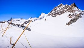 Stunning Beautiful Panoramic view of Snowcapped Bernese mountain alps Landscape in Jungfrau region, Bernese Oberland, Switzerland Royalty Free Stock Images