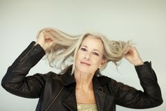 Stunning beautiful and self confident best aged woman with grey hair smiling into camera Royalty Free Stock Images