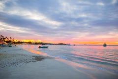 Amazing beautiful sunset on an exotic caribbean beach. Stunning beautiful sunset on an exotic caribbean beach Royalty Free Stock Photography