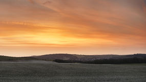 Stunning beautiful sunset over farm landscape with vibrant coors Royalty Free Stock Photo