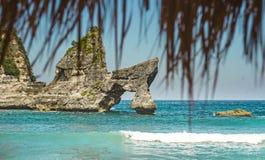 Stunning beautiful tropical island paradise landscape shot under beach straw umbrella panorama view of rocks on an amazing turquoi. Stunning and beautiful stock image