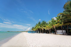 Stunning beautiful view of white sand inviting beach with people in background Royalty Free Stock Images