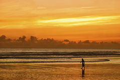 The stunning beauty of the sunset over the ocean in Indonesia Stock Photos