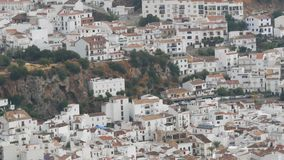 Stunning beauty of the white villages of Andalusia in Spain. Many white houses are high in the mountains,panoramic view. The stunning beauty of the white stock video