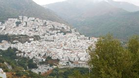 Stunning beauty of the white villages of Andalusia in Spain. Many white houses are high in the mountains,panoramic view. The stunning beauty of the white stock footage