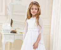 Stunning beauty young girl model in the white communion dress Royalty Free Stock Photo