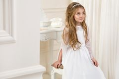 Stunning beauty young girl model in the white communion dress Royalty Free Stock Photography