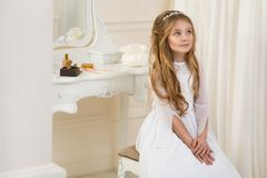 Stunning beauty young girl model in the white communion dress Royalty Free Stock Images