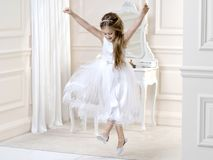 Stunning beauty young girl model in the white communion dress. Stands in an elegant palace Stock Photography