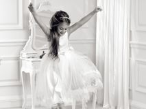 Stunning beauty young girl model in the white communion dress. Stands in an elegant palace Stock Image