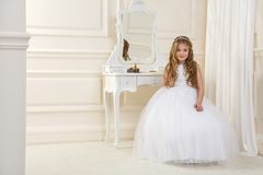 Stunning beauty young girl model in the white communion dress Royalty Free Stock Photos