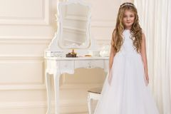Stunning beauty young girl model in the white communion dress Stock Photography