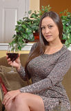 Stunning biracial woman in dress with wine Stock Photo