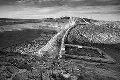Beautiful black and white landscape image of Hadrian`s Wall in N. Stunning black and white landscape image of Hadrian`s Wall in Northumberland at sunset with Royalty Free Stock Photos
