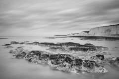Stunning black and white long exposure landscape image of low ti Royalty Free Stock Images