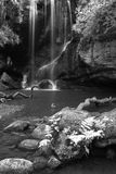 Beautiful calm black and white waterfall landscape at Roughting. Stunning black and white waterfall landscape at Roughting Linn in Northumberland National Park Royalty Free Stock Images