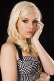 Stunning blond. Beautiful blond model posing on a black back ground Royalty Free Stock Photography