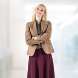 Stunning blond businesswoman standing in the Royalty Free Stock Photography