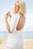 Stunning blond woman biting sunglasses Stock Image