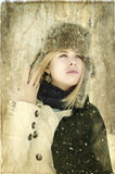 A stunning blond woman with piercing blue eyes wearing a hood in the winter. A stunning blond woman with piercing blue eyes wearing a hood and winter coat in Royalty Free Stock Photos