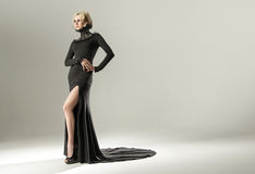 Stunning blond woman wearing black gown Stock Photography