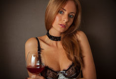 Stunning blonde holding glass of wine Royalty Free Stock Photos