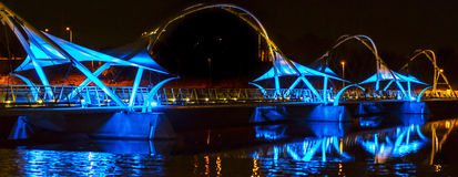 Stunning Blue and Amber Lights Of A Bridge With Reflection Stock Image