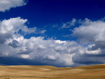 Stunning blue sky with clouds. Rnstunning blue sky with clouds above a field of ripe wheat Stock Images