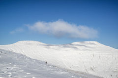 Stunning blue sky mountain landscape in Winter with snow covered Royalty Free Stock Image