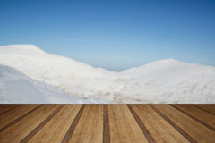 Stunning blue sky mountain landscape in Winter with snow covered Royalty Free Stock Photo