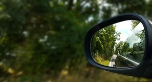 Relflection of road and trees in car wingmirror royalty free stock photos