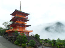 Stunning Bright Red Color Three-storied Pagoda in the Mist Royalty Free Stock Photography