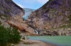 Stunning Briksdal glacier. Briksdal glacier with a lake in Olden, Norway Royalty Free Stock Photo