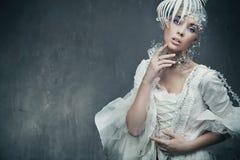 Stunning brunette beauty. Wearing vintage dress Royalty Free Stock Photography