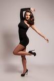 Stunning brunette in heels Stock Photography