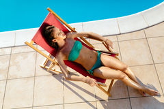 Stunning brunette resting and sunbathing Royalty Free Stock Image
