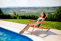 Stunning brunette resting and sunbathing Royalty Free Stock Photography