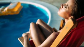 Stunning brunette resting and sunbathing. On her vacation royalty free stock photo